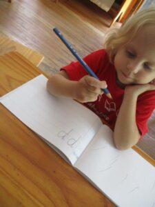 Montessori student observing a pencil